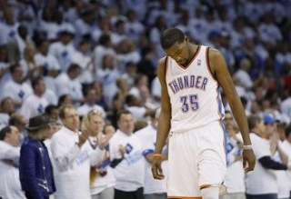 Oklahoma City Thunder forward Durant walks with his head down after a teammate fouled a Memphis Grizzlies player in Game 5 of their NBA Western Conference semi-final playoffs in Oklahoma City.
