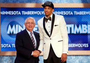 Roberson from the University of Colorado shakes hands with NBA Commissioner Stern after being selected by the Timberwolves as the 26th overall pick in the 2013 NBA Draft in Brooklyn