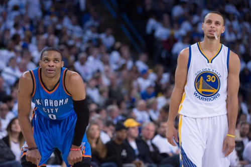 January 5, 2015; Oakland, CA, USA; Oklahoma City Thunder guard Russell Westbrook (0) and Golden State Warriors guard Stephen Curry (30) look on during the third quarter at Oracle Arena. The Warriors defeated the Thunder 117-91. Mandatory Credit: Kyle Terada-USA TODAY Sports