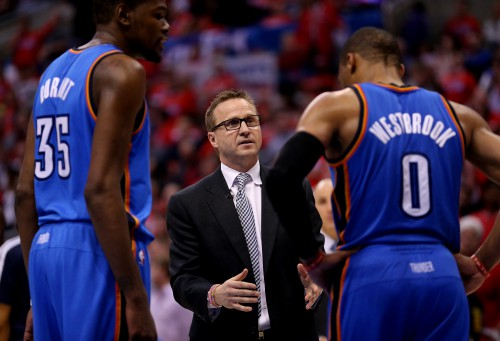 LOS ANGELES, CA - MAY 09: Head coach Scott Brooks of the Oklahoma City Thunder talks with Russell Westbrook #0 and Kevin Durant #35 against the Los Angeles Clippers in Game Three of the Western Conference Semifinals during the 2014 NBA Playoffs at Staples Center on May 9, 2014 in Los Angeles, California. The Thunder won 118-112. NOTE TO USER: User expressly acknowledges and agrees that, by downloading and or using this photograph, User is consenting to the terms and conditions of the Getty Images License Agreement. (Photo by Stephen Dunn/Getty Images)